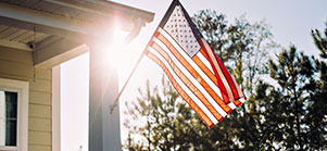 flag on a home representing thanks to military spouses